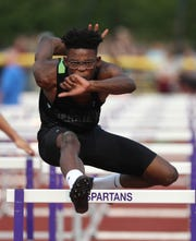 Rush-Henrietta's Tamaree Haygood during his first-place finish in the Division I 110-meter hurdles event.