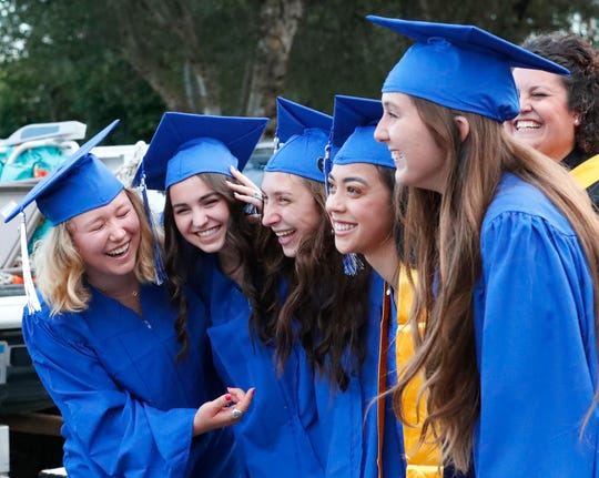 University Preparatory School graduates Ayla Clark, from left, Alyssa Brown, Lexi Jones, Audrie Reuss and Alexis Hayward pose for a photo before their commencement ceremony on May 31, 2019.