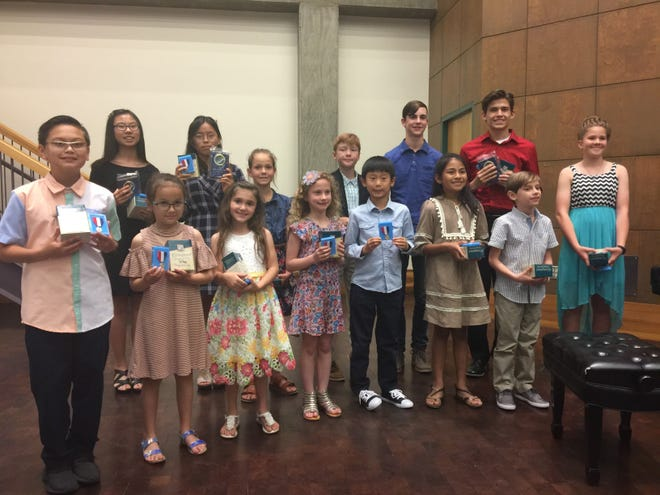 Piano students of Janelle Schlaudt and Joan Richling were presented in recital on Thursday evening, May 16, 2019 at the San Angelo Museum of Fine Arts. Performing solo and ensemble selections were (back row) Alayna Kang, Jane Kim, Amy Zesch, Hodge Hunter, Jonathan McGee, and Nathan Miller; (fromt row) Wesley Hale, Kiley Hale, Holt Hunter, Ava Jaeckle, Ethan Kang, Kaileigh Aguirre, Bryant Jaeckle and Stella Zesch. Following the performances students were presented awards for Texas Music Teachers State Theory Test and Studio Evaluations. Students unable to perform, but receiving awards were Cate and Mary Penry, Garret Glover and Neil Chinn.