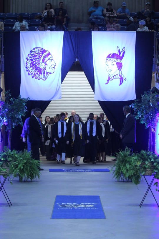 Lake View staff enter the graduation area ahead of the graduates at the Foster Communications Coliseum, 50 E. 43rd St., Saturday, June 1, 2019.