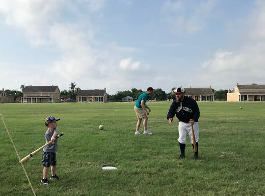 "Landon Robinson, 5, swings at a pitch from Cory ""Squirrel"" Robinson during Fort Concho's  1800s baseball demonstration Saturday, June 1, at Fort Concho, 630 S. Oakes St."
