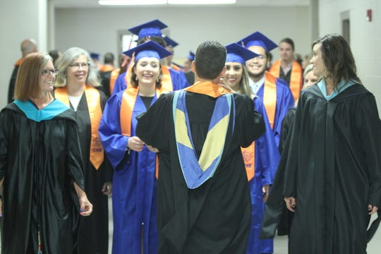 Central High School staff leads graduates into the gym at the Junell Center, 2235 S. Jackson St., Saturday, June 1, 2019.