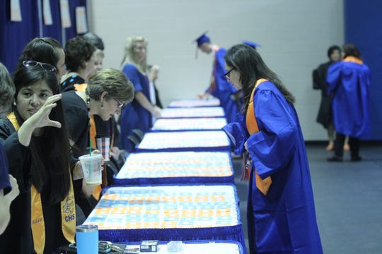 Central graduates find their name cards before graduating at the Junell Center, 2235 S. Jackson St., Saturday, June 1, 2019.
