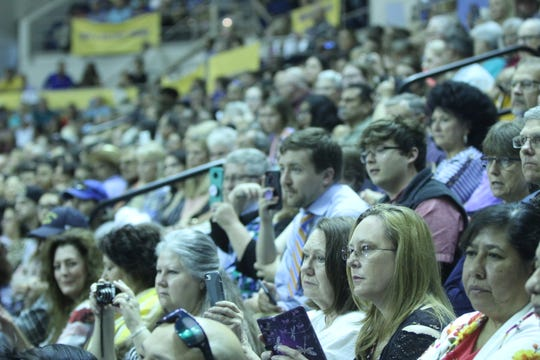 Families watch Central graduates walk into the gym at the Junell Center, 2235 S. Jackson St., Saturday, June 1, 2019.