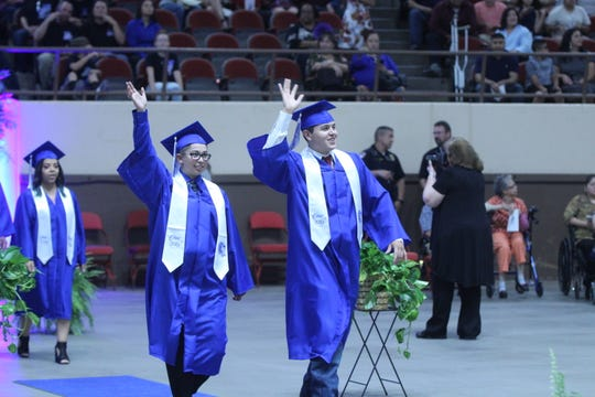 Lake View graduates wave at the crowd as they enter the room at the Foster Communications Coliseum, 50 E. 43rd St., Saturday, June 1, 2019.
