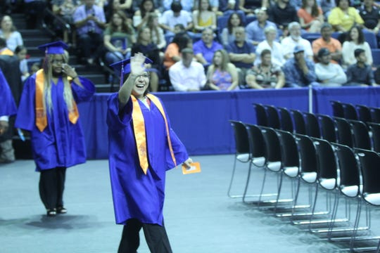 A Central graduate waves at her family during graduation at the Junell Center, 2235 S. Jackson St., Saturday, June 1, 2019.