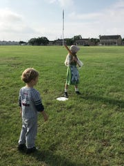 Natalie Thompson, 10, waits for the pitch as Ezra Thompson, 5, watching during Fort Concho's  1800s baseball demonstration Saturday, June 1, at Fort Concho, 630 S. Oakes St.