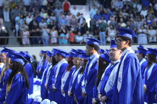 Lake View Graduates stand and wait for the ceremony to begin at the Foster Communications Coliseum, 50 E. 43rd St., Saturday, June 1, 2019.