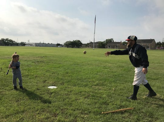 "Cory ""Squirrel"" Robinson pitches to Ezra Thompson, 5, during Fort Concho's  1800s baseball demonstration Saturday, June 1, at Fort Concho, 630 S. Oakes St."