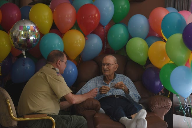 Tom Smotherman (left), scout executive of the Boy Scouts of America, Sioux Council, presents 101-year-old Duane Greenfield with four Eagle Palm awards at Greenfield's home in Sioux Falls on Saturday, June 1, 2019.