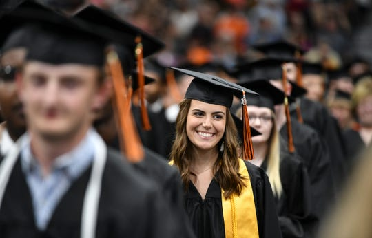 Graduates smile during the processional for the Tech High School graduation ceremony Friday, May 31, at the River's Edge Convention Center in St. Cloud.