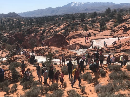 Large crowds gather in the waterfalls area beneath Gunlock Reservoir on March 24, 2019.