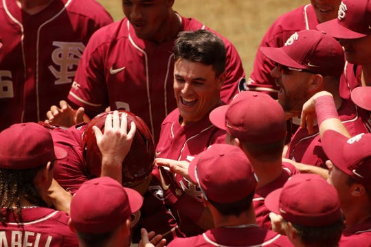 Florida State's Tim Becker (37) celebrates with teammates after hitting a twp-run home run against Florida Atlantic at the NCAA college baseball regional tournament in Athens, Ga., Friday, May 31, 2019. (Joshua L. Jones/Athens Banner-Herald via AP)