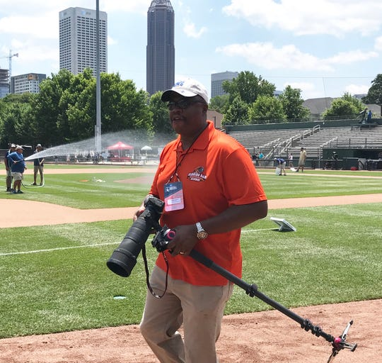 FAMU associate athletics director/executive producer of Rattler Productions Vaughn Wilson gets set to take pregame photos at Russ Chandler Stadium in Atlanta on Saturday, June 1, 2019.
