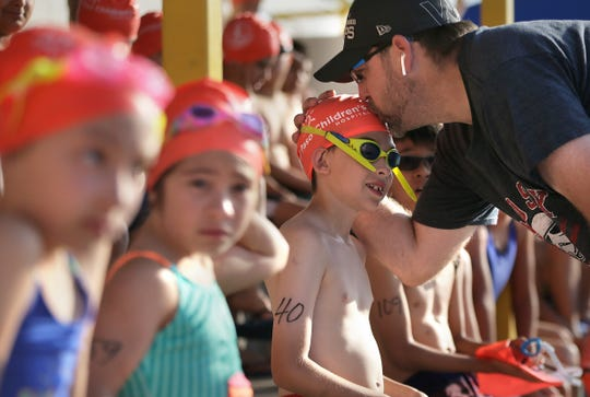 A competitor in the Sun City Splash and Dash gets a little last-minute encouragement from dad before hitting the pool Saturday, June 1, 2019, at Ascarate Park.
