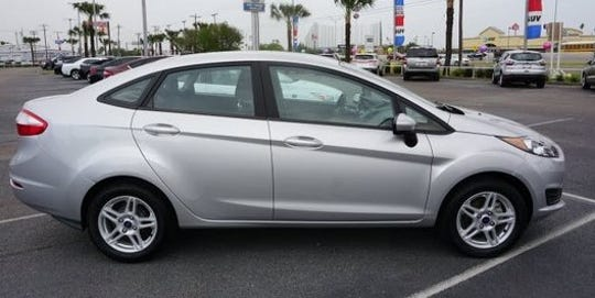 Photo of a gray, four-door 2019 Ford Fiesta. One was stolen from a woman during a robbery May 20 at a home in the 1200 block of Marr Street in Central El Paso.