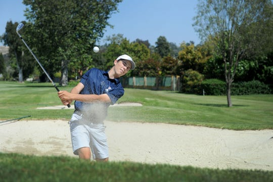 Camarillo's Joey Zambri blast a bunker shot during one of his daily practice sessions at Las Posas Country Club.