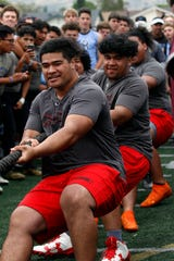 Grace Brethren's Jojo Taase, front, and Izzy Uili, pull with the Grace Brethren A team against Royal in the final round of the tug-of-war at the annual Ventura County Football Coaches Hogs Tournament at Simi Valley High on Saturday. Grace Brethren won the battle and finished first overall.