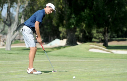Camarillo's Joey Zambri hits a putt while practicing at Las Posas Country Club. Zambri finished his junior season with a 73.2 scoring average.