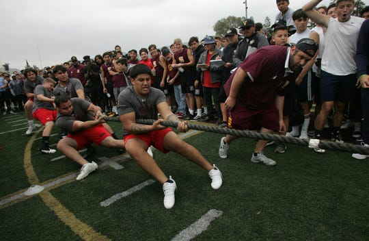 Coach Tyler Staley carefully watches the rope indicator as Danny Valenzuela, center, Zachary Collins and the rest of the Grace Brethren B team battle Royal at the annual Ventura County Football Coaches Hogs Tournament at Simi Valley High on Saturday.
