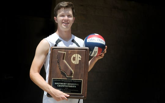 Justin Stone holds the Division II CIF-State SoCal Regional championship plaque, which the Oak Park program won for the first time.