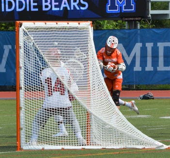 Mamaroneck attackman Will Martin unleashes a shot in the first half of a 10-4 win over Kingston on June 1, 2019 in a NYSPHSAA regional final at Middletown High School.