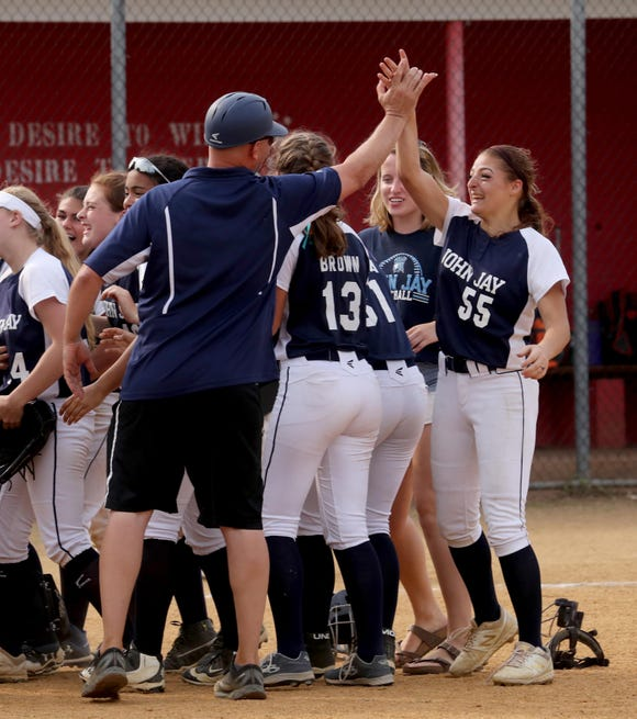 John Jay East Fishkill celebrates after defeating White Plains 12-0 in the Section 1 Class AA softball championship game at North Rockland High School June 1, 2019.