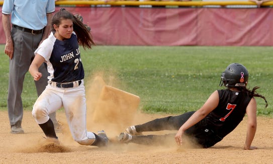 Second base goes flying as Jaycee Falencia of John Jay-East Fishkill tags out Evelyn Flores on a caught stealing during the Section 1 Class AA softball championship game at North Rockland High School on June 1, 2019. John Jay East Fishkill defeated White Plains 12-0.