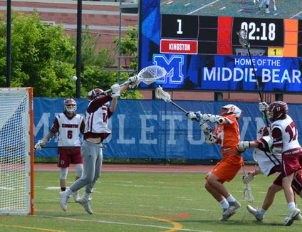 Grant Malas picked up a ground ball on the doorstep and quickly extended Mamaroneck's lead in the first quarter of a 10-4 win over Kingston in a NYSPHSAA Class A regional final at Middletown High School on June 1, 2019.