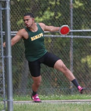 Ramapo's Anthony Harrison competes in the disc competition during the Section 1 State Track and Field Qualifier at Arlington High School in LaGrangeville May 31, 2019.