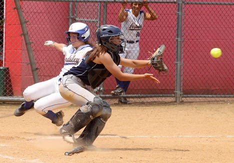 Lauren Rende of Ardsley scores as Putnam Valley catcher Alex Waters takes the late throw during the Section 1 Class B softball championship game at North Rockland High School June 1, 2019. Ardsley defeated Putnam Valley 16-5.
