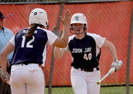 Gaelen Kelly of John Jay East Fishkill his congratulated by Madison Mason after scoring during the Section 1 Class AA softball championship game at North Rockland High School June 1, 2019. John Jay East Fishkill defeated White Plains 12-0.