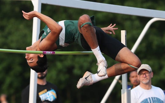 Yorktown's Omar Tabanjeh clears the bar in the boys high jump during the Section 1 State Track and Field Qualifier at Arlington High School in LaGrangeville May 31, 2019.