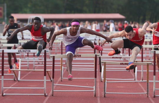 New Rochelle's Jessie Parson (center) wins the boys 110 meter hurdles with North Rockland's Emmanuel Joesph and Ryan Curtis coming in second and third during the Section 1 State Track and Field Qualifier at Arlington High School in LaGrangeville May 31, 2019.