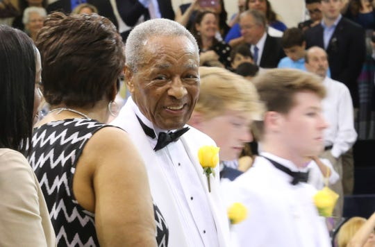 Fred Smith, one of the first black students to enroll at Salesianum in 1950, watches as seniors file into the school's commencement Friday in Wilmington. Smith was drafted into the Army as a senior and never completed his degree. He was honored with his diploma at the Class of 2019 commencement.