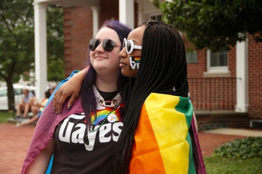 Hailey Foster, left, of Dover and Geena Handy of Camden celebrate Delaware's first Pride Parade in downtown Dover on Saturday.