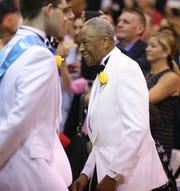 Fred Smith watches as the Class of 2019 files past at the end of Salesianum's commencement Friday, May 31, 2019 in Wilmington. Smith had been among the first black students to attend the school but never completed his degree when he was drafted at age 18. The school awarded him his diploma at the ceremony.