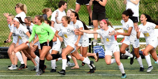 Padua players rush out onto the field as time expires in the Pandas' 4-1 win over Charter of Wilmington in the DIAA Division I Girls Soccer championship game on Saturday at Dover High School.