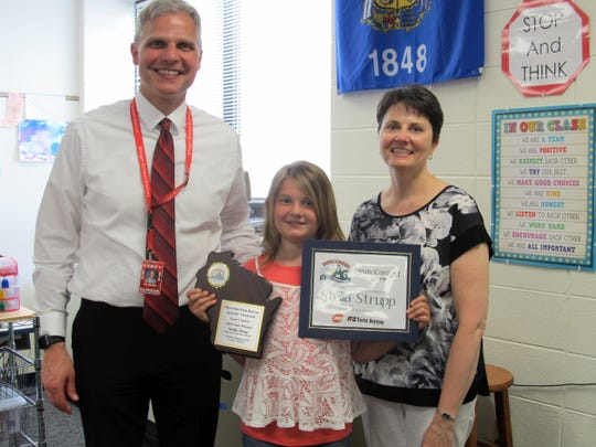 Fourth grade Appleton student Stella Strupp was the state winner in the Ag in the Classroom essay contest. Pictured (from left) are Superintendent of Schools Daren Sievers, Stella Strupp and fourth grade teacher Rebecca Schuett.