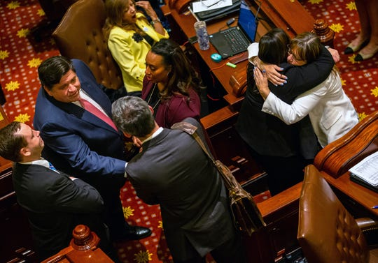 Illinois Gov. J.B. Pritzker, left, and Sen. Melinda Bush, D-Grayslake, right,  celebrate passage by Senate of the Reproductive Health Act on May 31, 2019, in Springfield, Ill.