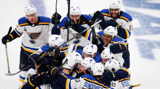 Blues players celebrate after the Game 2 win in Boston.