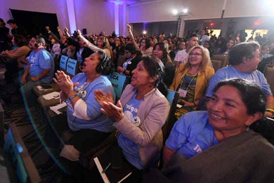 Migrant rights activists cheer as Democratic presidential candidites address migrant-rights organizations at the 'Unity Freedom Presidential Forum' in Pasedena, California on May 31, 2019. - Democratic presidential contenders, Kamala Harris, Bernie Sanders, former US Secretary of Housing and Urban Development Julian Castro and Washington Gov. Jay Inslee attended the event.