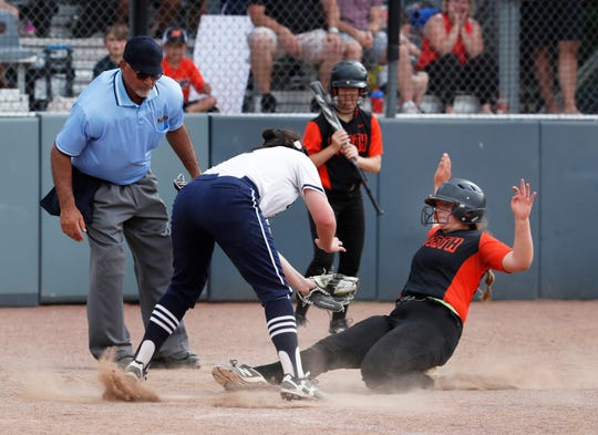 Mia Botti is called safe for her team's fifth run of game. Middletown North Softball defeats Chatham 5-0 in Group 4 State Championship in Union, NJ on June 2, 2019.