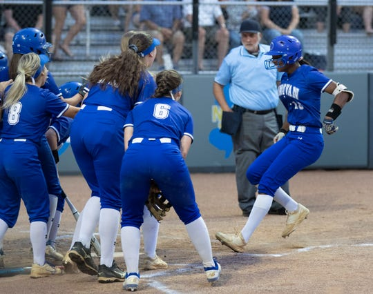 Donovan Catholic's Jayda Kearney is greeted at the plate after hitting a first inning three run homer. Donovan Catholic Softball defeats Mount Saint Dominic Academy in a five inning mercy rule win of Non-Public A State Championship in Union, NJ on June 1, 2019.