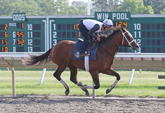 Maximum Security with exercise rider Edelberto Rivas breezes at Monmouth Park, Sunday morning