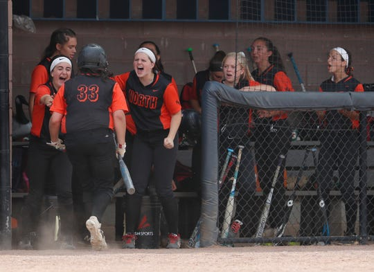 Jacey Tammaro is greeted by team mates after scoring her team's fifth run. Middletown North Softball defeats Chatham 5-0 in Group 4 State Championship in Union, NJ on June 2, 2019.