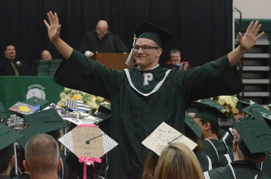 Pennfield graduating senior Scott Greene stands for the crowd as he is named in a story by commencement speaker and Pennfield Assistant Principal Joe Thomas during graduation ceremonies at the school Sunday, June 2, 2019.