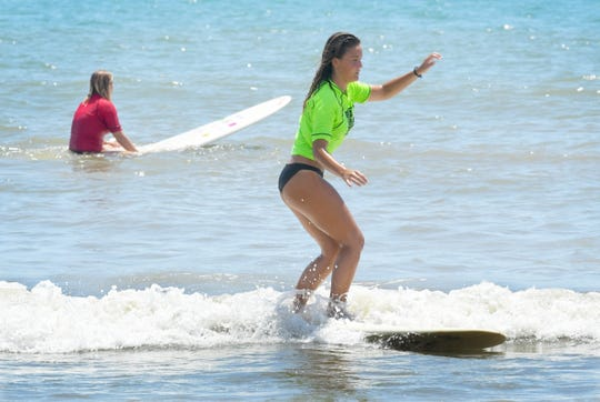 Caroline Noack in a finals heat.The 19th Annual Waterman's Challenge , organized by the Florida Surf Museum, was held June 1st and 2nd at International Palms Resort in Cocoa Beach.