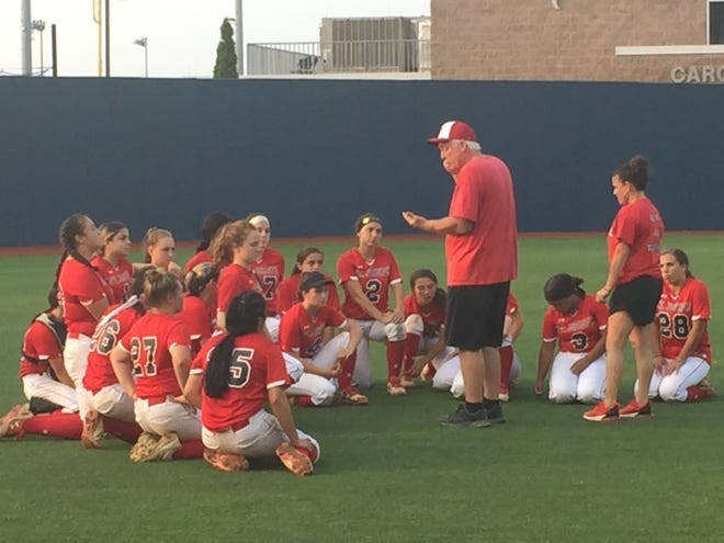 St. Joseph coach Les Olson, center, talks to his softball team after Sunday's 4-0 loss in the state Non-Public B final.