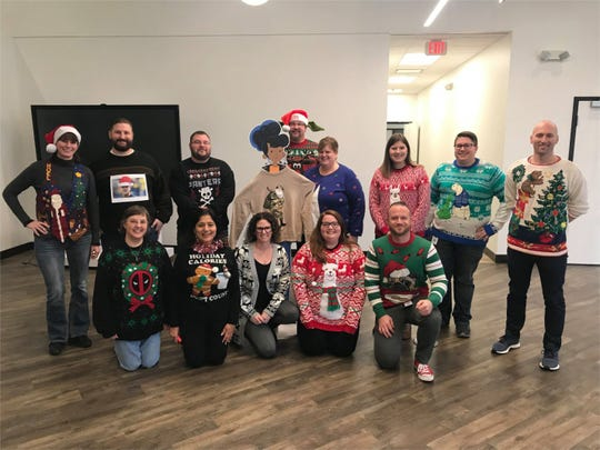 PCMS employees at the ugly holiday sweater contest.